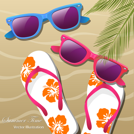 Flip- flops in the sand, sun glasses and palm leaves