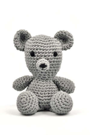 crocheted: Crocheted grey woolen Teddy Stock Photo
