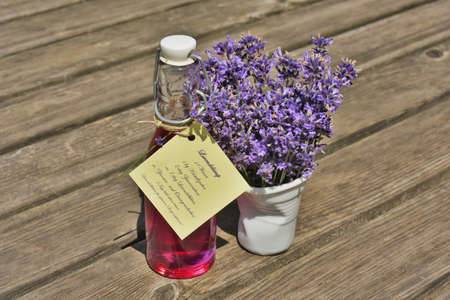 lavandula angustifolia: Homemade Lavender Syrup in a bottle with a bouquet of Common Lavender (Lavandula angustifolia). Recipe in German attached to the bottle.