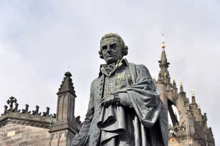 savant: Edinburgh, Great Britain - July 7, 2010: Statue of Adam Smith in Edinburgh in front of St.Giles Cathedral at Parliament Square.