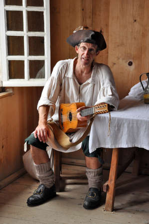 national historic site: Cape Breton,  CANADA - July 30, 2013: Musician in a historic pub at Louisbourg Fortress, National Historic Site, Nova Scotia, Canada