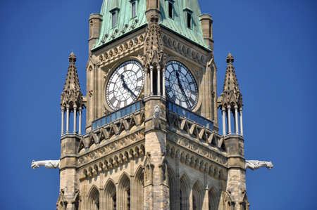 governmental: Ottawa, USA - July 15, 2013: Peace Tower of the Canadian Parliament building on Parliament Hill in Ottawa Editorial