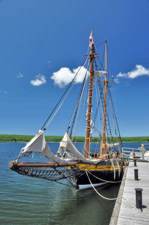 topsail: Reconstruction of the armed British gaff topsail schooner HMS Bee, a supply ship at Discovery Harbour historical site in Penetanguishene, Ontario. The Brithsh had a naval base at the Great Lakes in the first half of the 19th century. Editorial