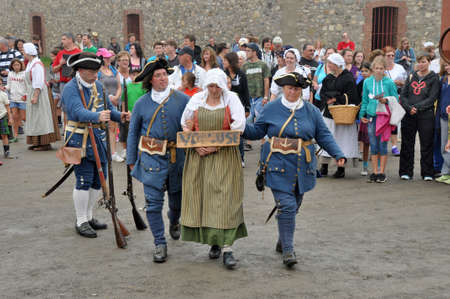 national historic site: Show with actors in historic costumes at Louisbourg Fortress at Louisbourg Fortress, National Historic Site, Nova Scotia, Canada