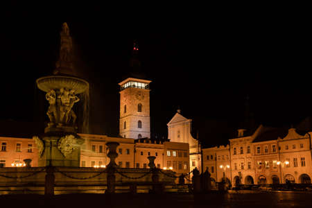 Main square of Budweis with fountain and Black Tower at night