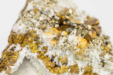 The Chalcopyrite (CuFeS2) contains Copper, Iron and Sulfur here in combination with Quartz Stock Photo