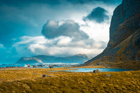 Scenic view of the village Eggum and the mountains of Lofoten Islands on a stormy day in autumn. Zdjęcie Seryjne - 131495948