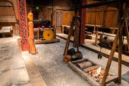BORG, NO - SEPTEMBER 2018 - Inside the historic replica of a furnished viking longhouse at Lofotr Viking Museum, Lofoten Islands.