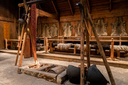 BORG, NO - SEPTEMBER 2018 - Inside the historic replica of a furnished viking longhouse at Lofotr Viking Museum, Lofoten Islands.