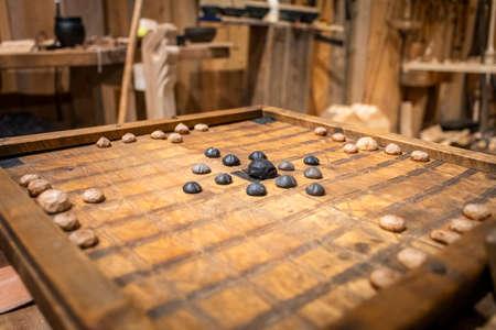 BORG, NO - SEPTEMBER 2018 - Replica of the historic viking boardgame Hnefatafl