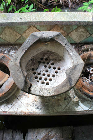 stoking: Old clay stove for traditional cooking in Thailand