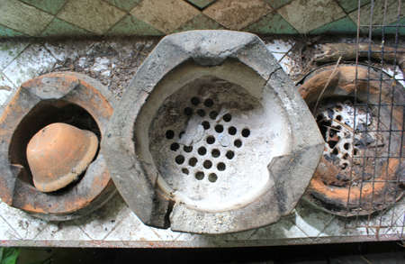 stoking: Old clay stoves for traditional cooking in Thailand  Stock Photo