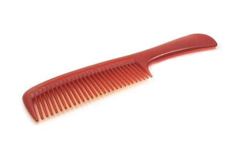 comb hair: Pettine rosso su sfondo bianco