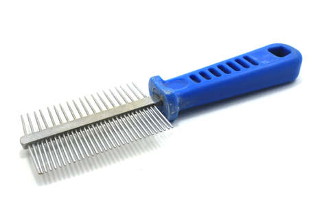 Comb (groomer) for remove fur moult in cats and dogs isolated Stock Photo - 21568814