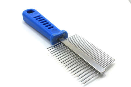 Pets comb with two rows of prongs on white background photo