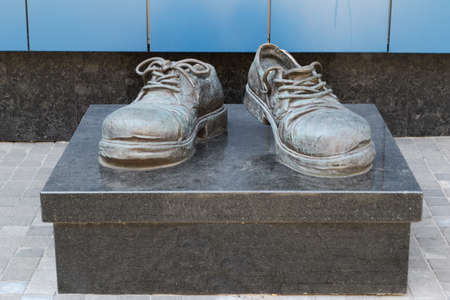 trampled: a monument to the shoes of the commercial agent, which the worker worn out looking for clients. installed near the office center. Ukraine, Kiev
