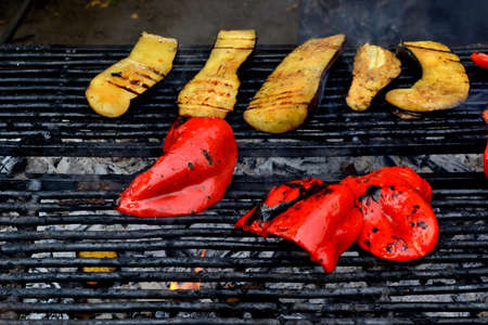 brazier: eggplant and pepper grill, street food, deliciously cooked on the coals in the brazier Stock Photo