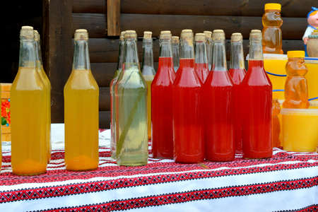 bebidas alcoh�licas: Ukrainian national alcoholic beverages with herbs, berries and fruit. colorful, bright, tasty