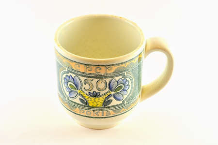 the ussr: Isolated image. great white ceramic cup with the inscription in Russian, 50 years of the USSR