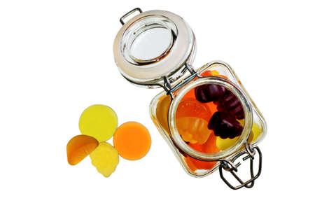Fruit gummi candies with bottle assortment on white Stock Photo