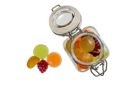 gummi: Fruit gummi candies with bottle assortment on white Stock Photo