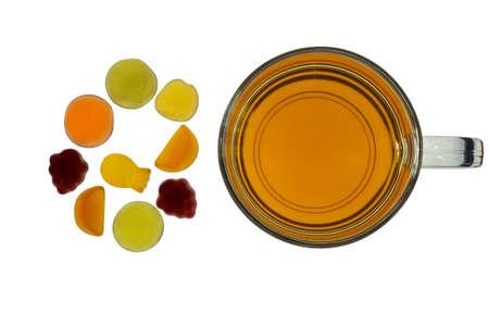 gummi: Fruit gummi candies with tea assortment on white Stock Photo