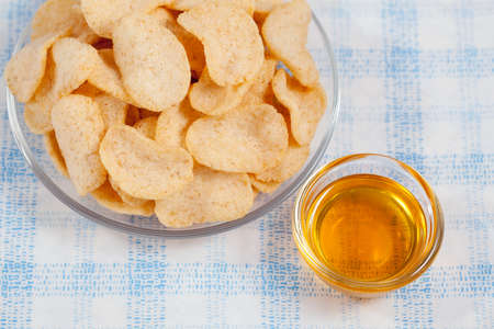 grissini: Grissini sticks, potato chips and other salty snacks with honey