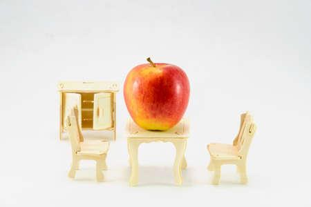 little table: Ripe apple on little table