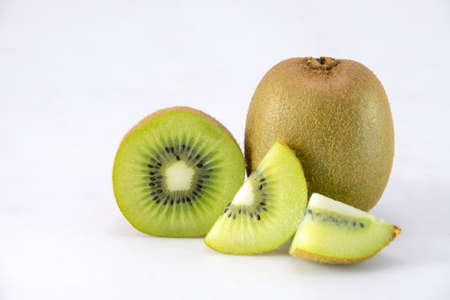 cantle: Whole kiwi fruit and his sliced segments isolated on white background cutout