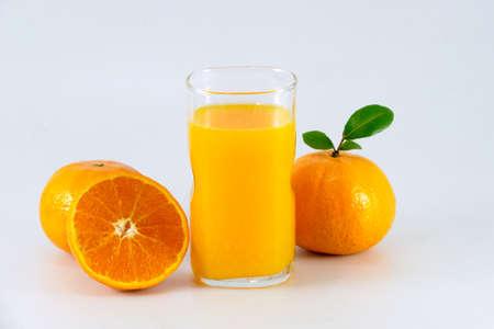 non alcoholic beverage: Orange juice and slices of orange isolated on white