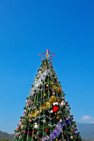 Christmas tree with colorful ornaments with sky