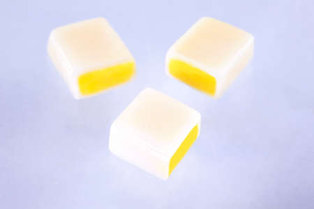 caramel fruity candies on white