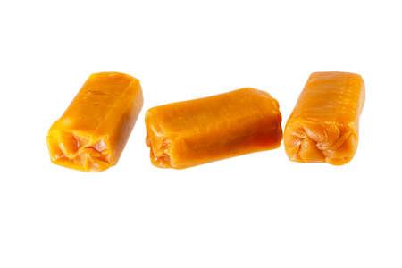 キャラメルお菓子、白い背景で隔離のグループ 写真素材