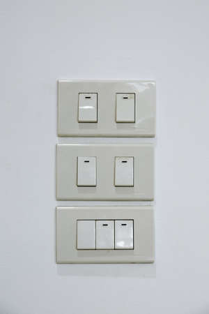 modern electrical light switch isolated on white Standard-Bild