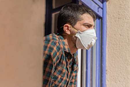 Coronavirus. Quarantine. Isolated confined at home. Man with mask virus outbreak.