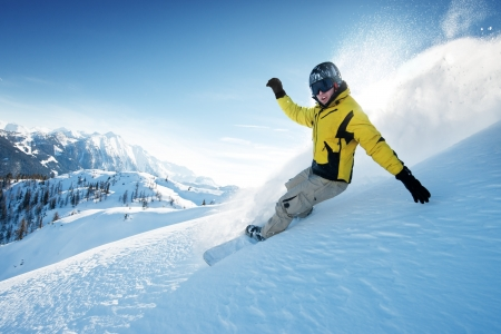 freeride: Young snowboarder in deep powder - extreme freeride