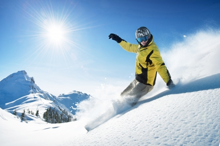 Young snowboarder in deep powder - extreme freeride Stock Photo - 9326513