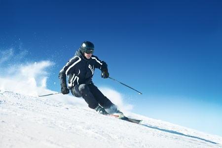 Skier in high mountains - alpine photo