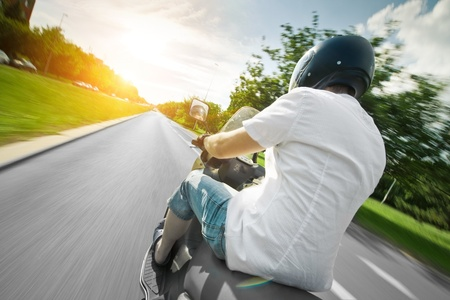parkway: Rider on motorcycle in beautiful parkway road - nature
