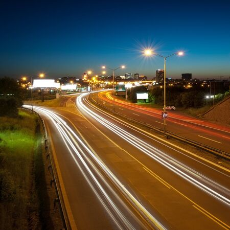 Highway in to the big city at night - central Europe - Prague photo