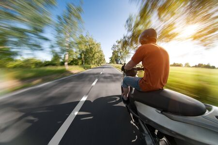 motorcycle road: Rider on motorcycle in beautiful parkway road - nature