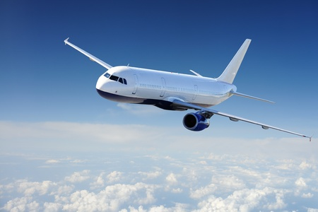 airplane travel: Airplane in the sky - Passenger Airliner  aircraft  Stock Photo