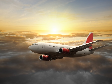luxury travel: Airplane in the sky at sunset - Passenger Airliner  aircraft