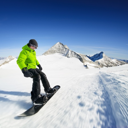 piste: Snowboarder on piste in high mountains
