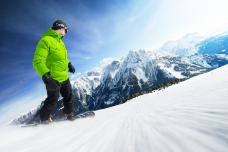Snowboarder on pise in high mountains Stock Photo