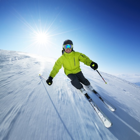 downhill: Skier on pise in high mountains