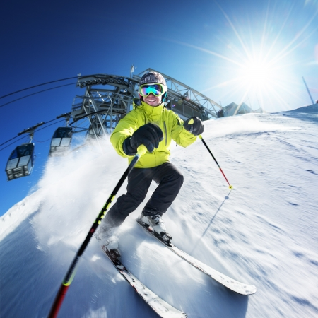 on skis: Skier on pise in high mountains