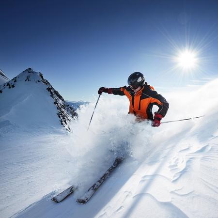 ski resort: Skier in high mountains