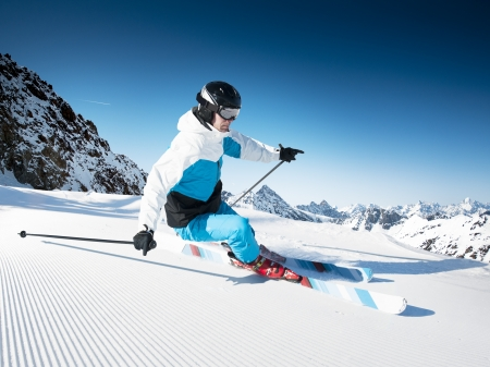 piste: Skier in mountains, prepared piste and sunny day