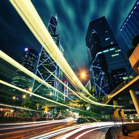 Hong Kong City center at night with light trails 免版税图像
